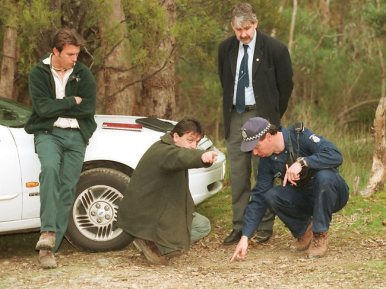 Search and rescue police are helped by Warrandyte State Park staff before they ascend one of 44 gold mine shafts in the in the park searching for Elisabeth's remains.