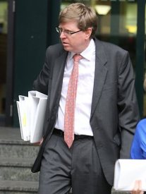 Senior Council Peter Davis, pictured leaving the Roma Street Police Headquarters on an unrelated matter, has been engaged to represent Gerard Baden-Clay.