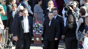 The coffin holding murdered woman Allison Baden-Clay is carried from St Paul's Anglican Church at Ipswich