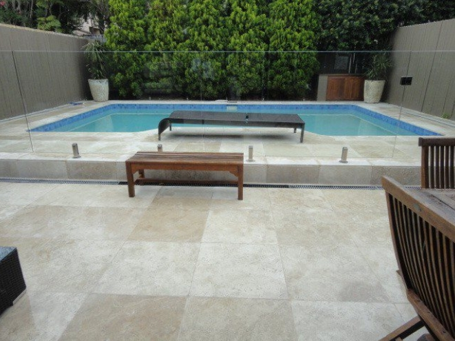 Marble stone seen in a home swimming pool project as pool copping and paver