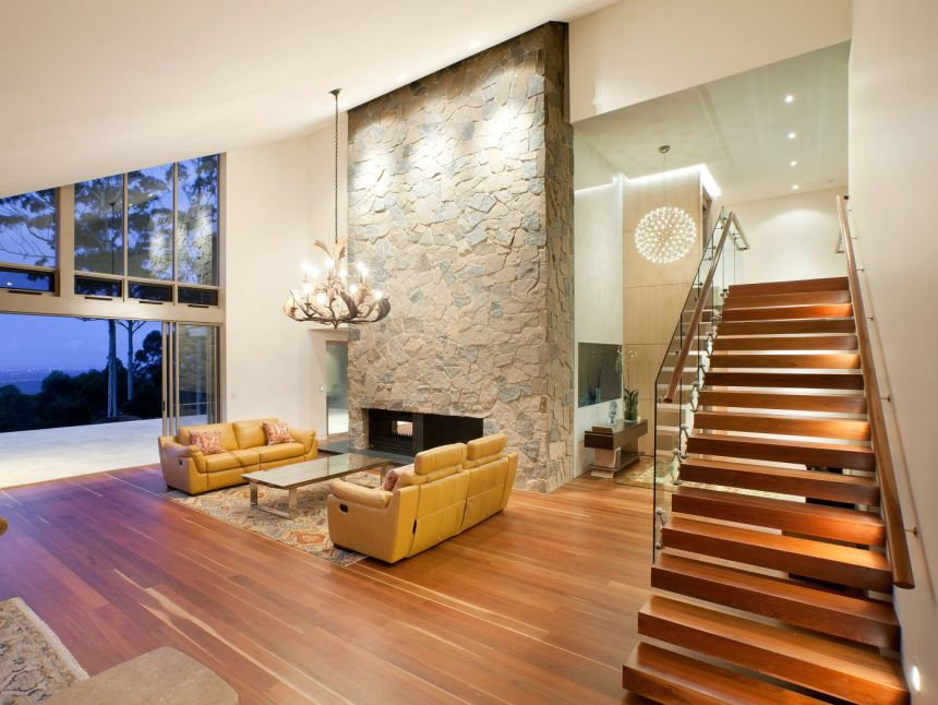 residential home interior design of stone walls and floors with timber