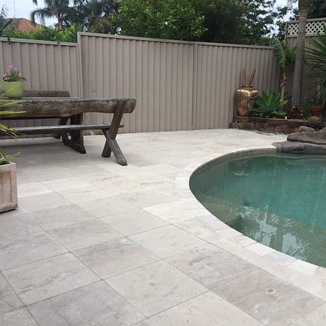 Cattai marble stone seen in a home swimming pool project as pool copping and paver