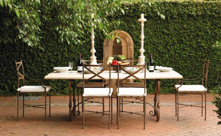 Table set in an outdoor dining place with stone floors
