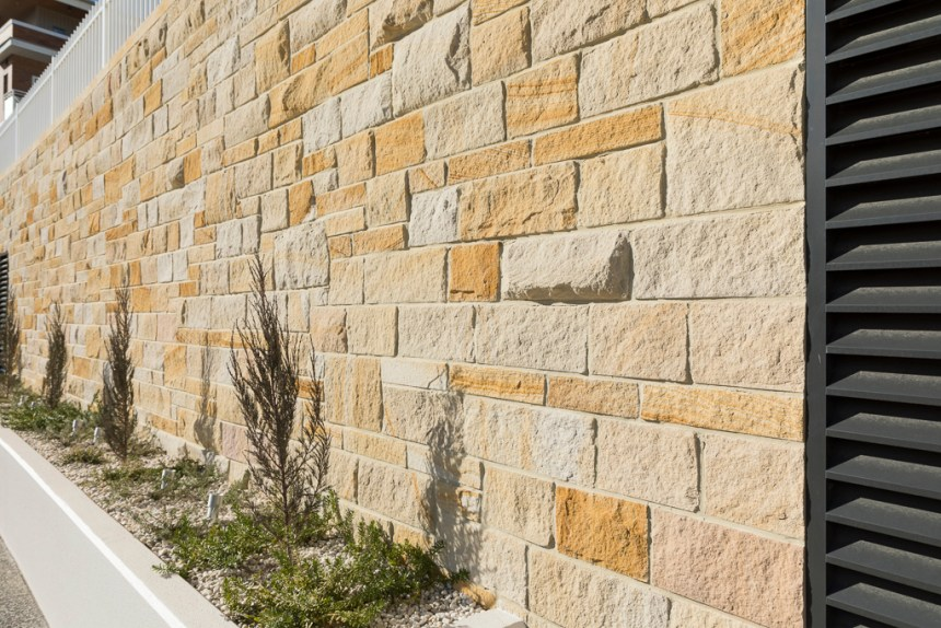 residential home building projects use sandstone walling veneers with some landscapes