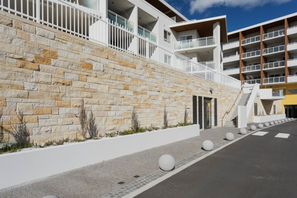 Sandstone wall at Goodwin Farrer using aussietecture 3 set stones wall cladding and sandstone cappings