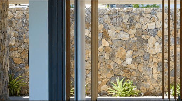 A building in Sydney with stone walls that using Aussietecture Eyre stone wall claddings