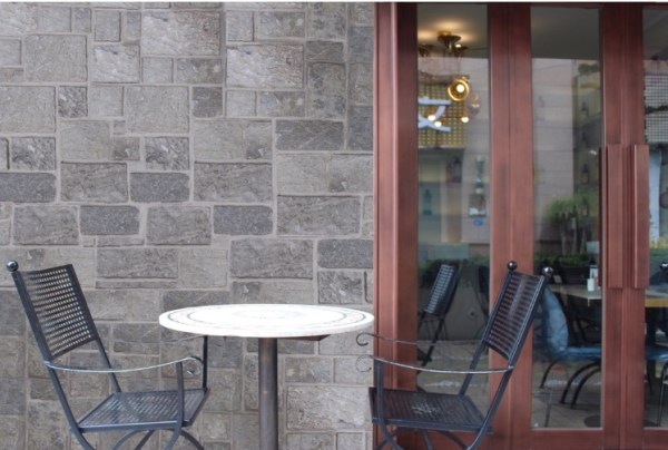Aussietecture Beltana colonial wall stone claddings used in a house entertaining area with some furniture