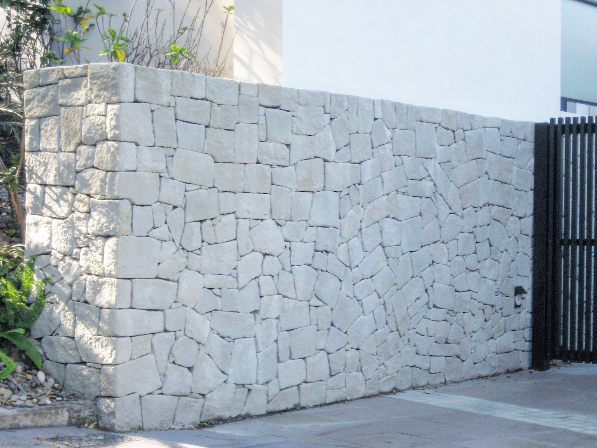 Colonial white Cladding stone walling seen in a house wall design in sydney