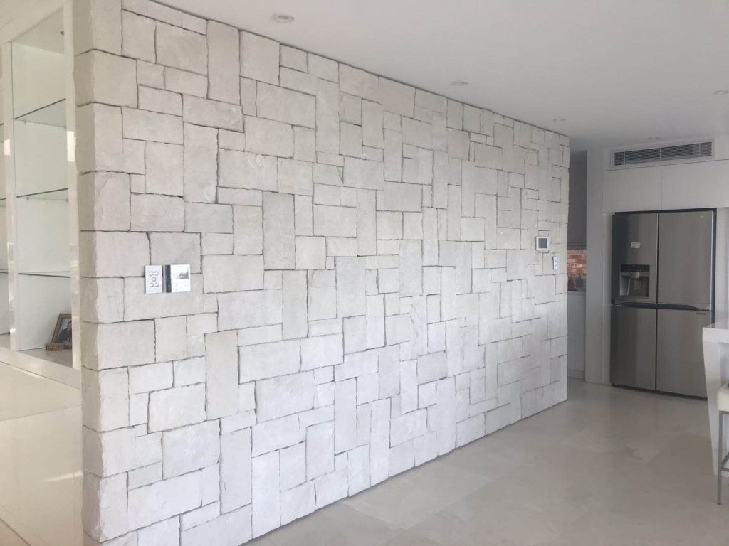 House interior feature wall design clad with white natural sandstone wall cladding