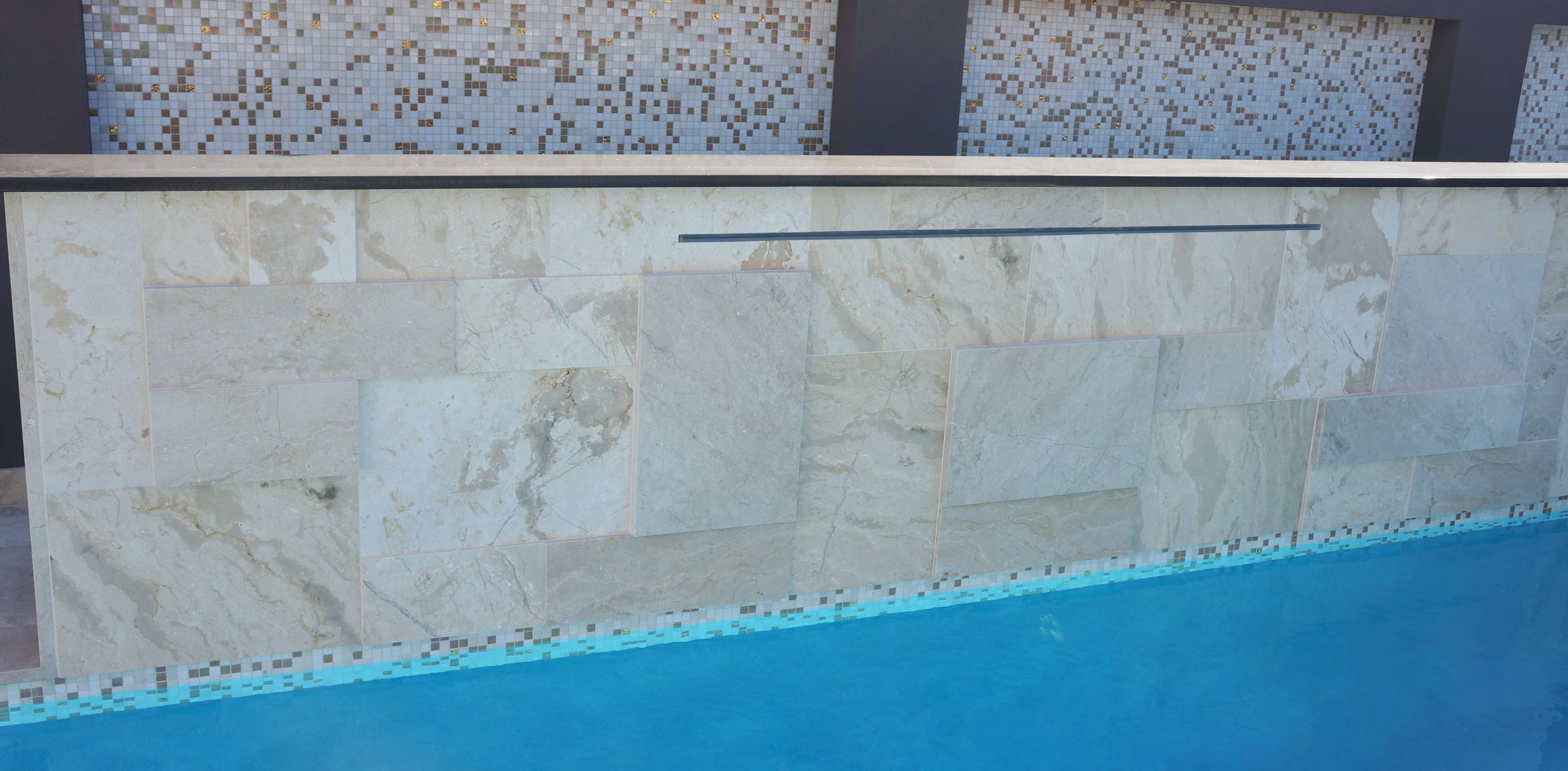 Swimming pool floor and wall design using Gundy marble natural stone tiles