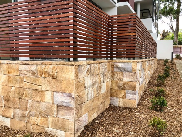 Natural split face kirra Ranch sandstone wall claddings and coping stones used in a residential house wall