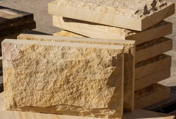 Stone wall cladding with a rockface finish