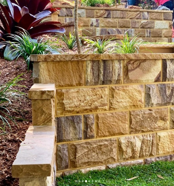 Garden Retaining wall project using sandstone split blocks and stone capping