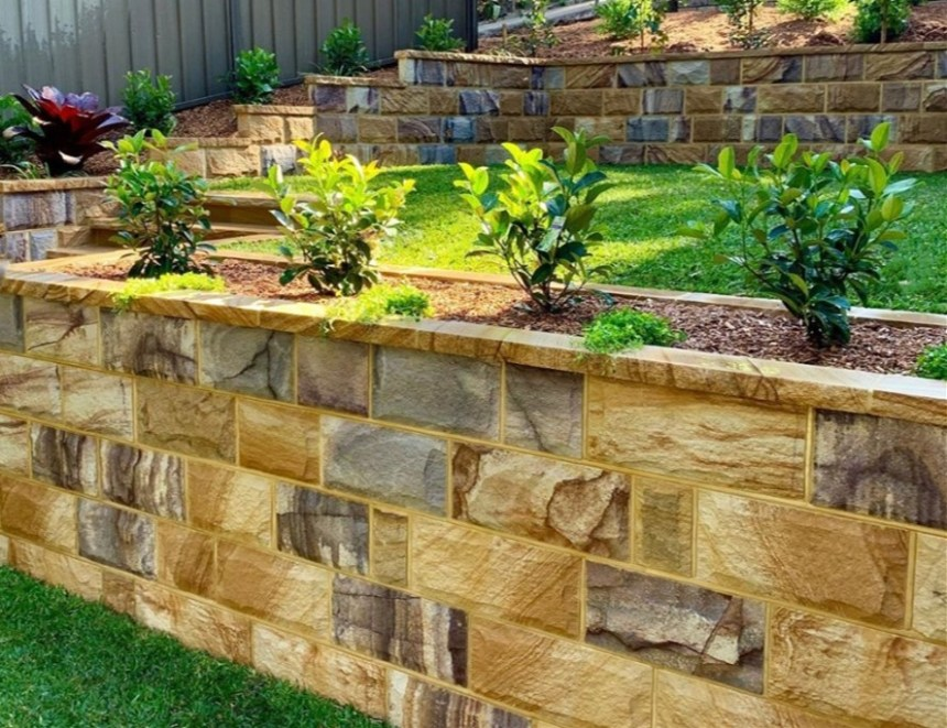 Garden retaining wall project using Aussietecture rockface ranch sandstone and copping stone.