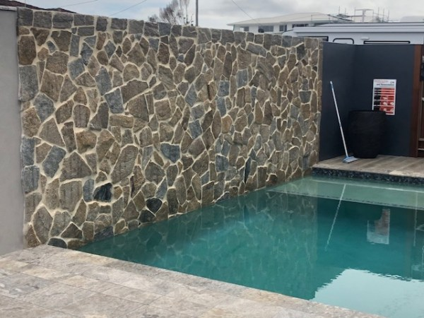 Swimming pool project using Tilpa irregular natural stone walling and limestone paver