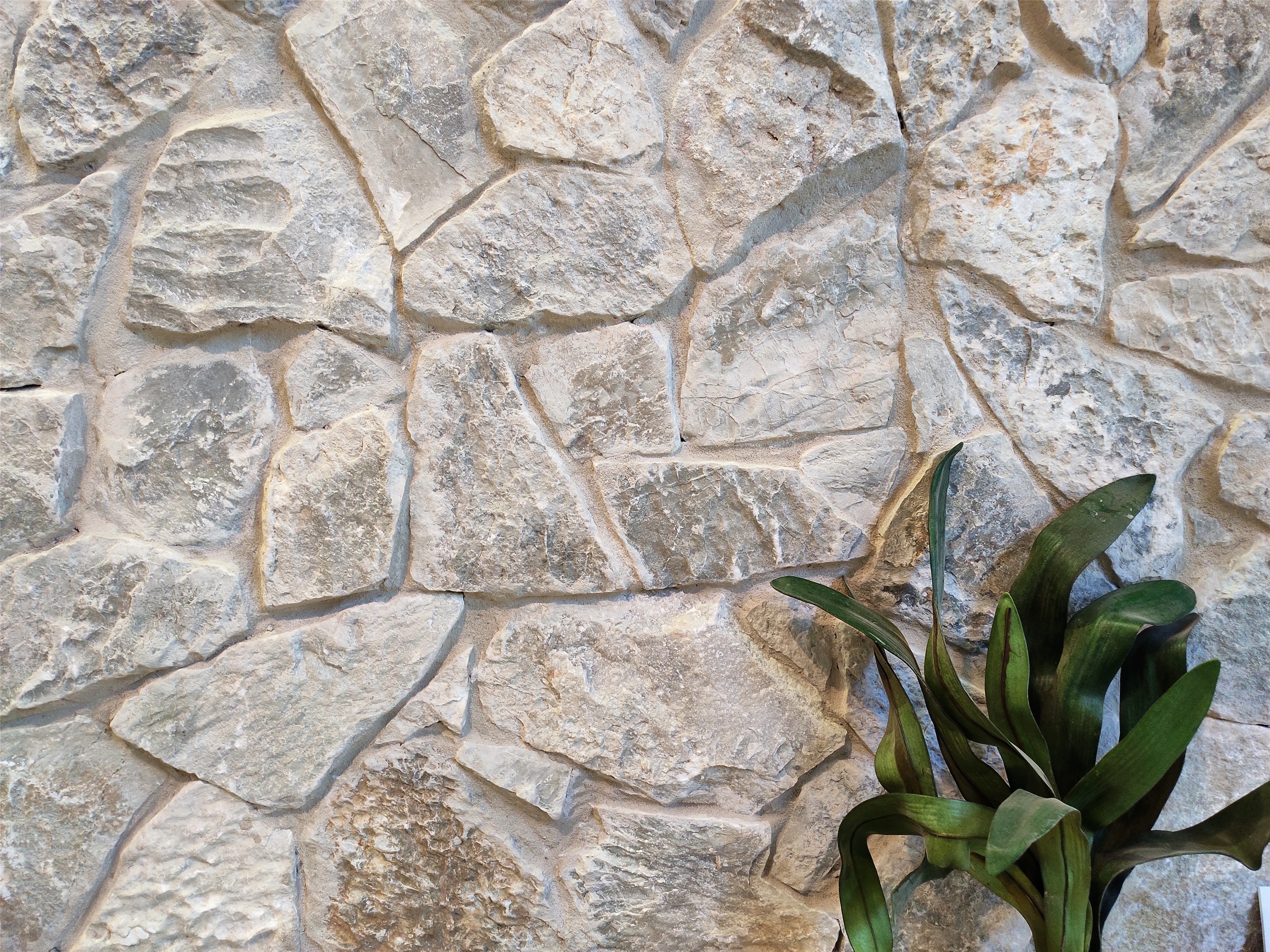 Beltana irregular limestone wall cladding seen in Aussietecture showroom in Alexandria, NSW Australia