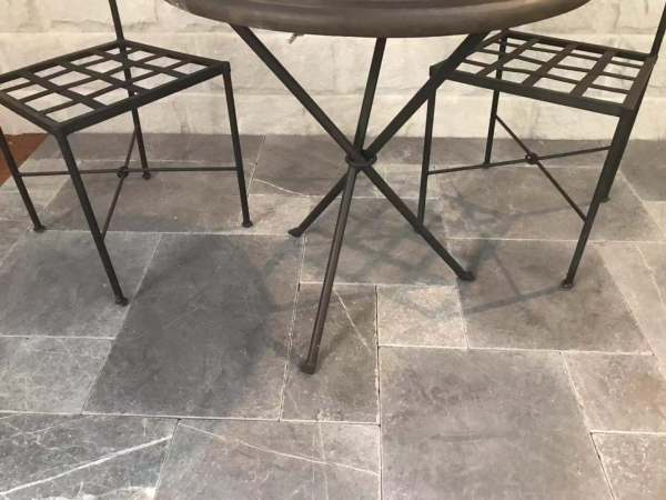 Interior floors designed with Bindoon limestone paving with some furniture from yardware