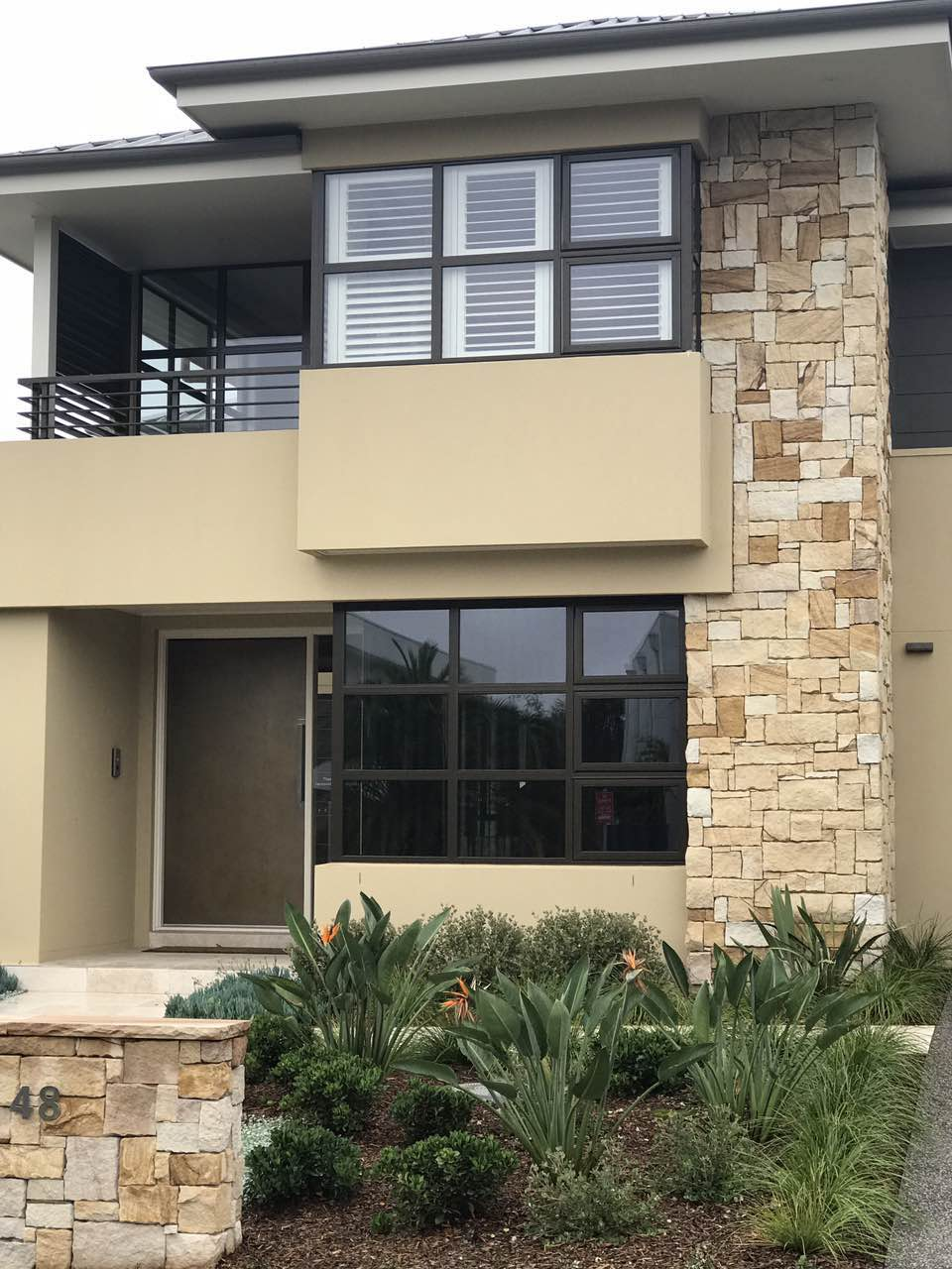 Residential building project using Aussietecture Australian sandstone wall claddings in exterior wall and garden design