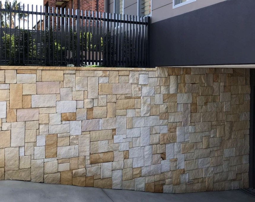 A residential exterior feature wall design using colonial sandstone walling