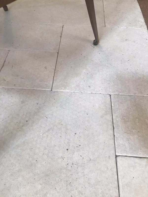 Interior floor using Aussietecture Derby stone flooring, tumbled limestone pavers with some furniture