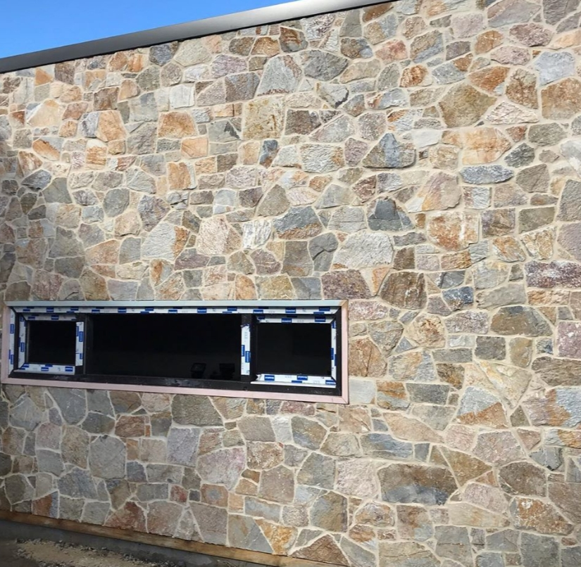 A stone house wall in Marina lane beach using Laverton irregular Limestone walling cladding