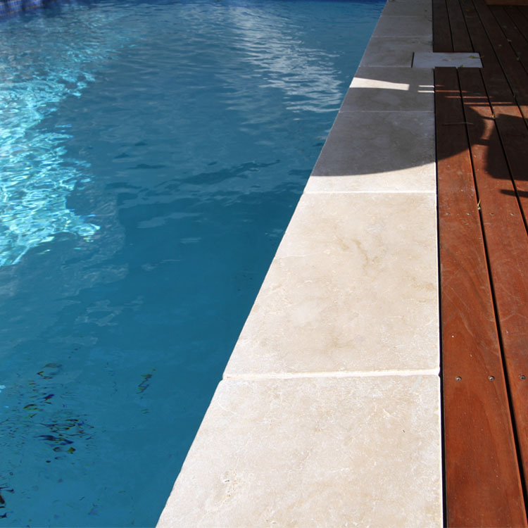 Swimming pool project using Cattai tumbled marble pavers