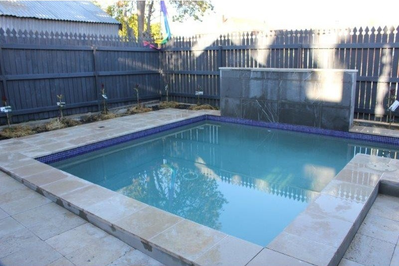 Natural stone pavers made from limestone seen here in a residential swimming pool