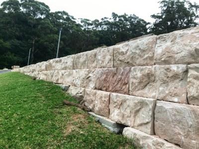 Australian sandstone logs used in a landscape project as retaining wall blocks