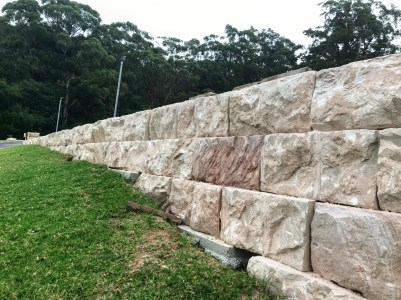 Australian sandstone logs used in a landscape project as retaining wall blocks