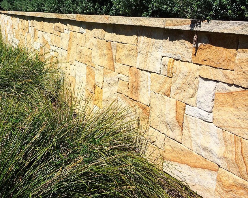 Aussietecture banded colonial sandstone seen in a landscaping project as wall claddings