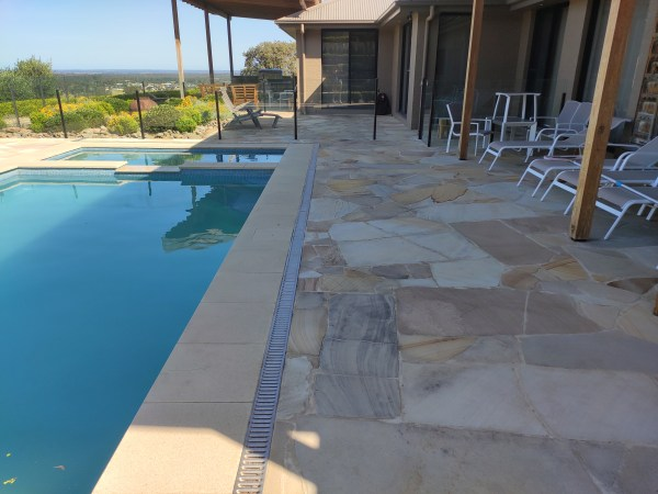 Aussietecture sandstone crazy paving as flooring in a swimming pool area