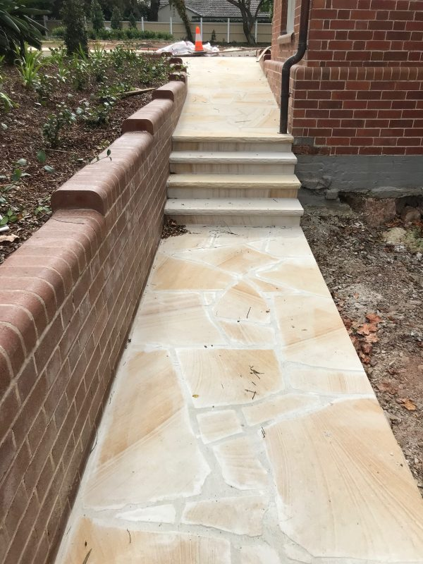 Banded Sandstone Crazy paving and sandstone treads used in house pass way