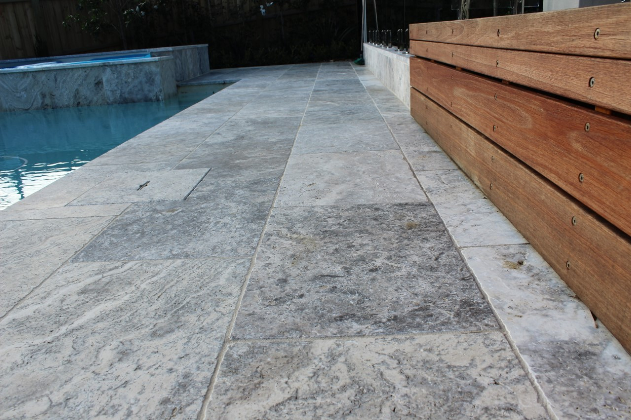 Silverton Travertine stone pave in swimming pool flooring
