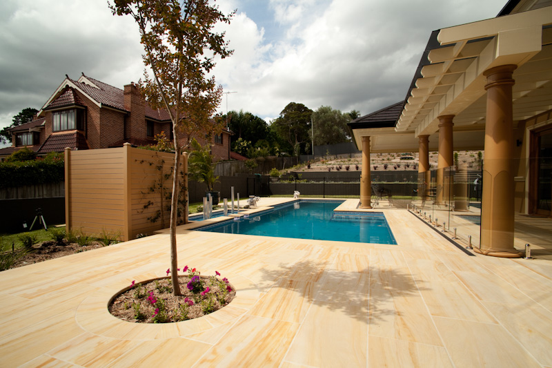 imported honed sandstone pool coping and pool tiles