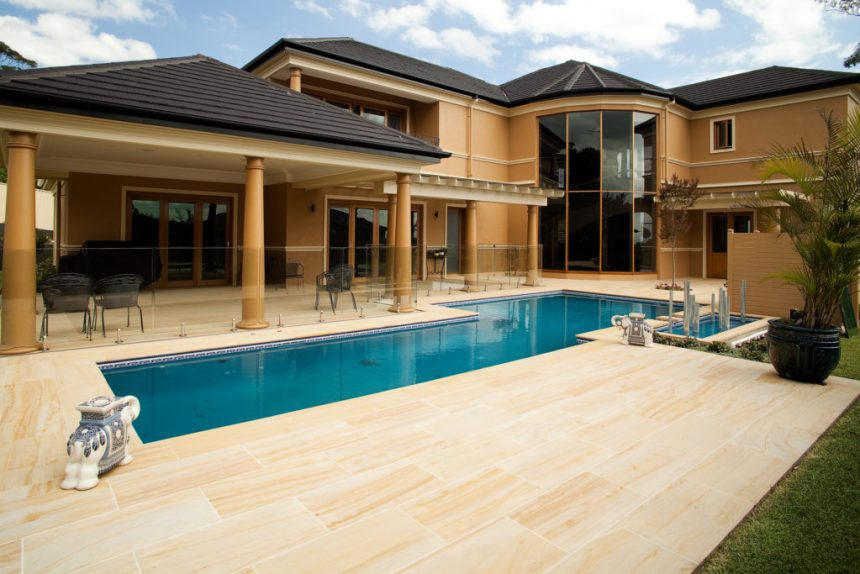 Teakwood-Sandstone-Honed-paver in a residential swimming pool floor project