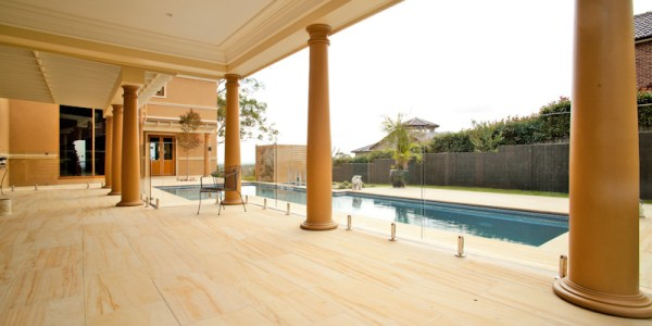 Sydney residential house project of a swimming pool and Outside entertaining spaces paved with teakwood honed sandstone paver