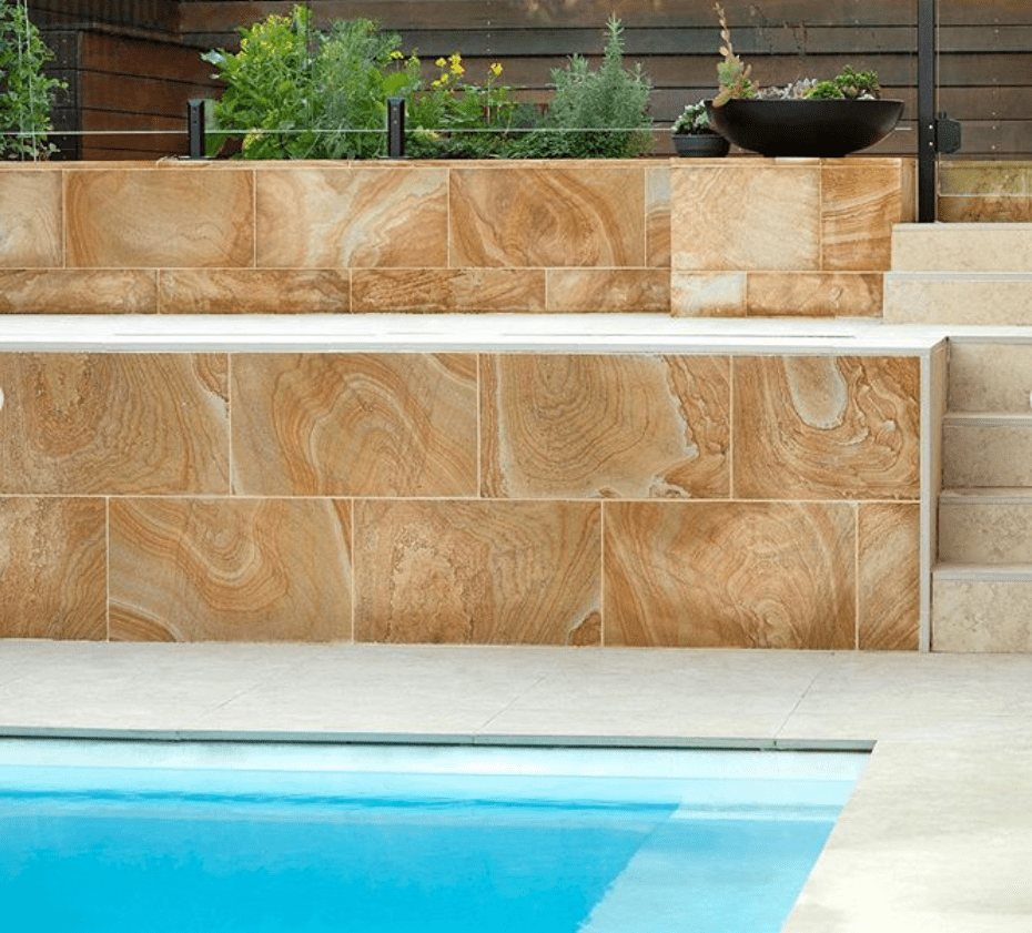 Banded brown Australian sandstone paver in pool area