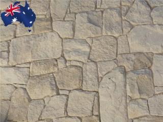 White irregular sandstone walling