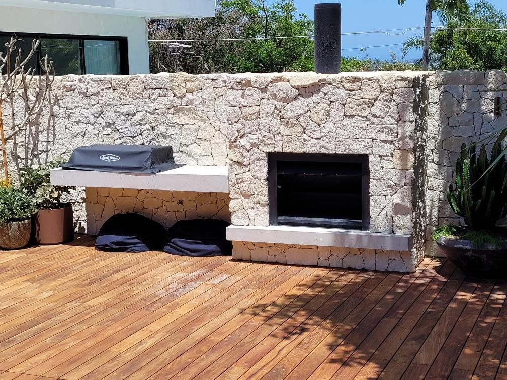 Australian white sandstone walling fire place with timber flooring