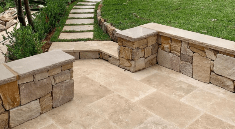 Ranch irregular Australian sandstone cladding and travertine paver in a residential project