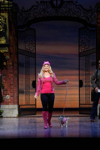 Lucy Durack as Elle with Bruiser in LEGALLY BLONDE. Image by Jeff Busby