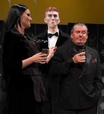 Aurelie Rouque, Connor Clarke, and Richard Murphy in The Addams Family - Brisbane Arts Theatre. [image supplied].
