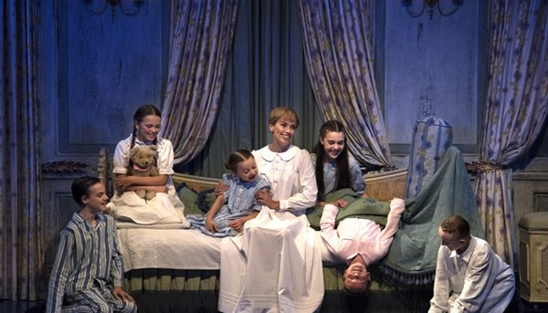 Amy Lehpamer as Maria, with the Von Trapp children in The Sound of Music. Photography by James Morgan.