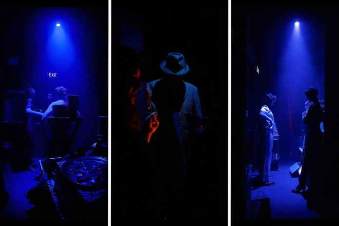 The cast wait backstage in the dim blue down lights