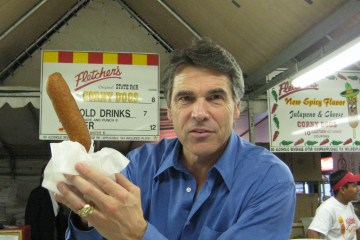 Gov. Perry holding a corndog. Photo: Flickr user James Joel, creative commons licensed.