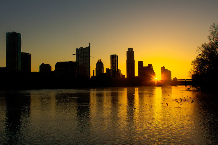 The sun rising over the Wells Fargo building in Austin, TX in February 2013. Photo: Wikimedia Commons.