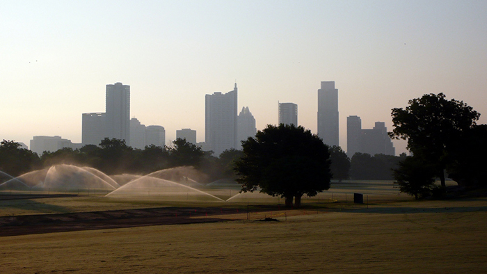 Zilker Park Great Lawn watering sprinklers misty foggy humid dew morning