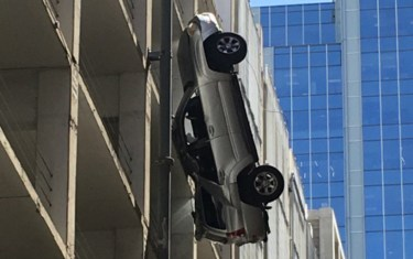 So, Um, There Was A Hanging Car Sticking Out Of A Building In Austin On Friday