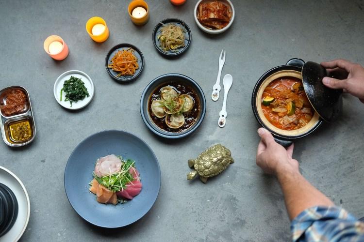 Oseyo Assorted Banchan, Kimchi Jigae, Hwedup Bap (raw fish over rice), Jin Mandu (steamed dumplings)