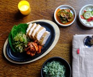 Oseyo . Bo Ssam (Pork Belly), cucumber kimchi, pickled vegetables